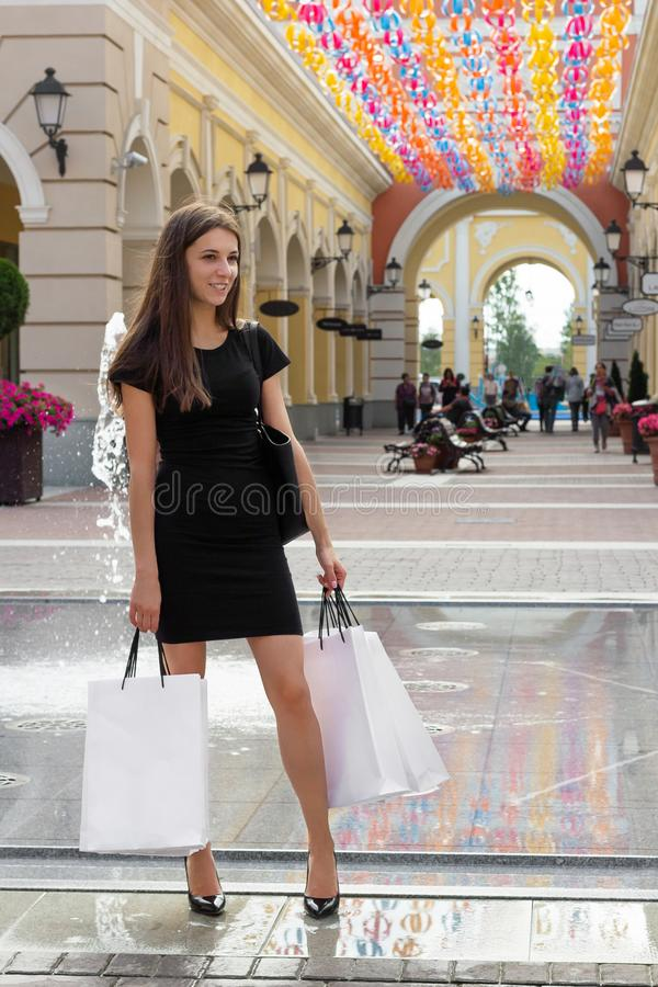 Girl stands with purchases shopping attractive length happy women stock photography
