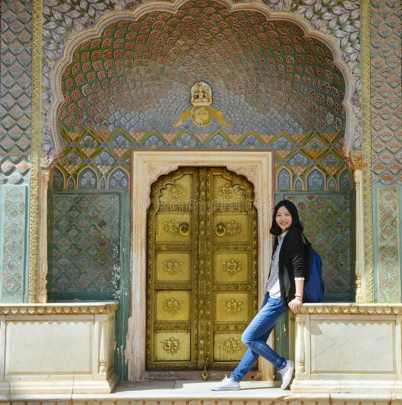 Girl stands before Rose Gate in City Palace, Jaipur, India. Single young Chinese girl stands before Rose Gate Winter Gate, located in the City Palace, Jaipur stock images
