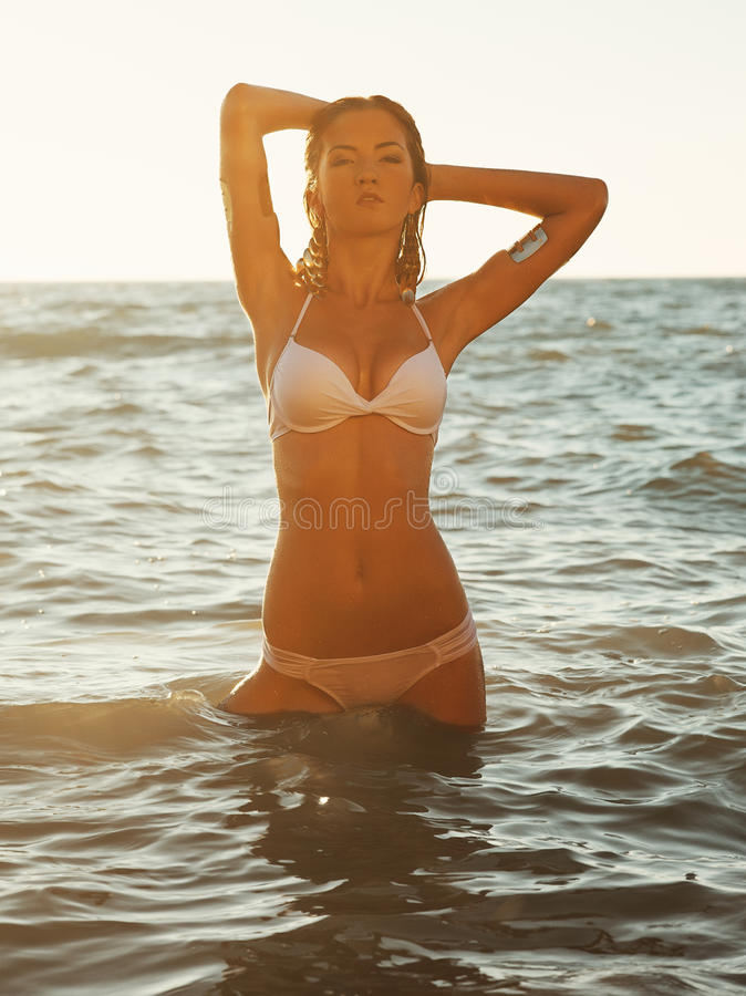 Girl stands in the sea royalty free stock photos