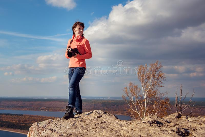 Girl taking pictures of the landscape stock images