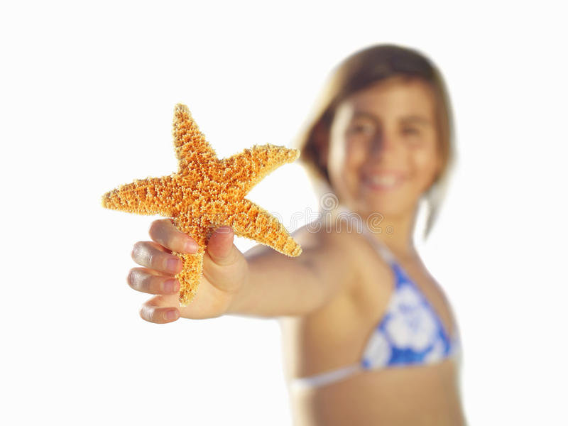 Girl with starfish, close-up of hand, cut out stock photo
