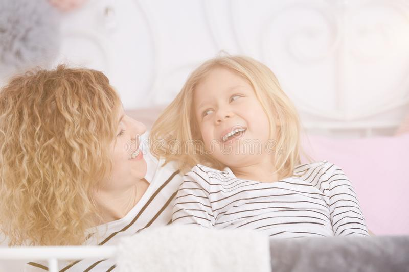 Girl staring at her mom stock photos