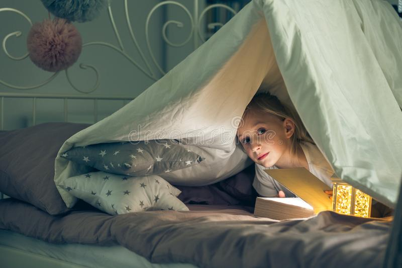 Girl staring at someone. Girl lying in bed and staring at someone royalty free stock photography