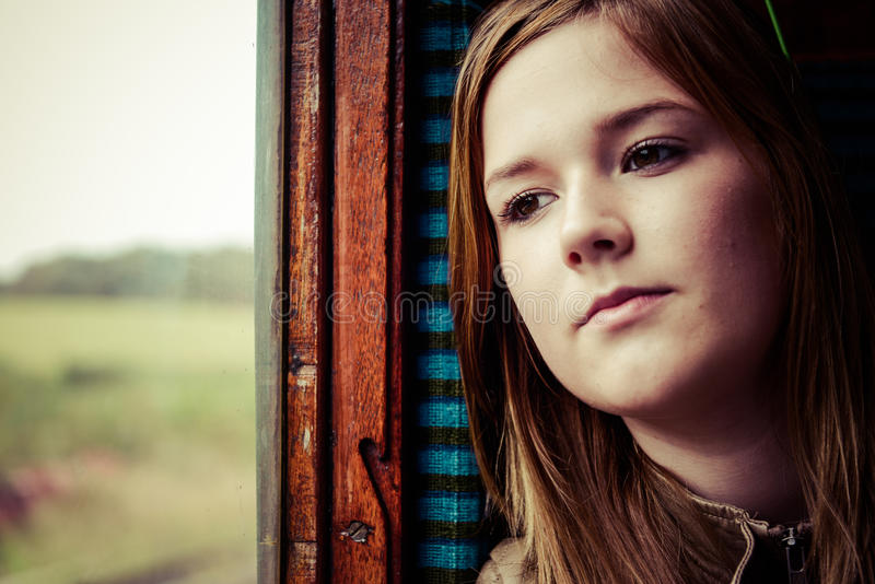 Download Girl Staring Trough A Window While Travelling By Train Stock Image - Image: 32262581