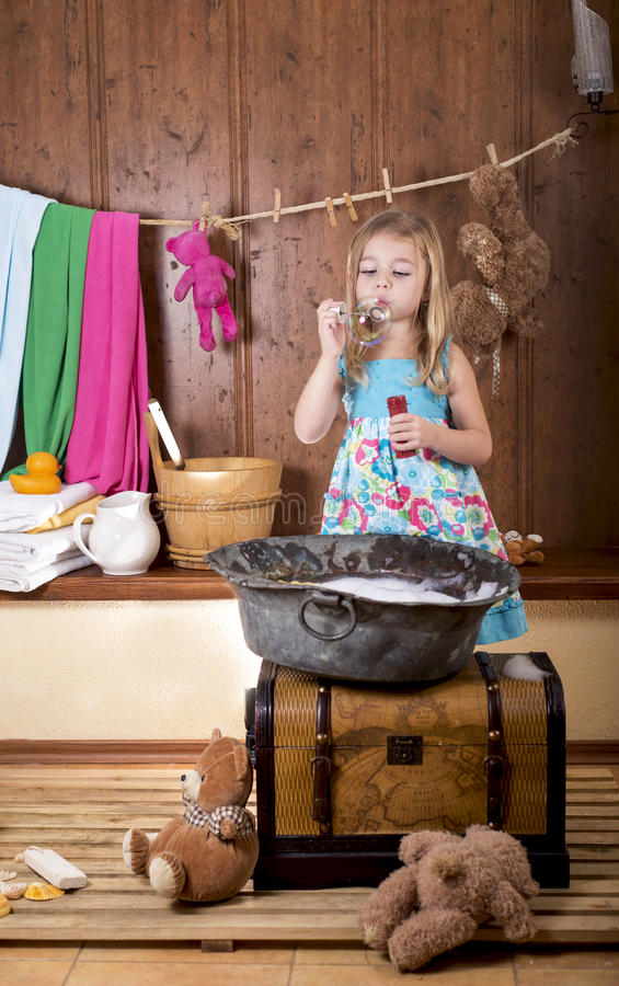 Girl starts up soap bubbles royalty free stock photo