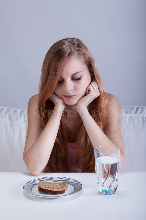 Girl on a starvation diet stock photo