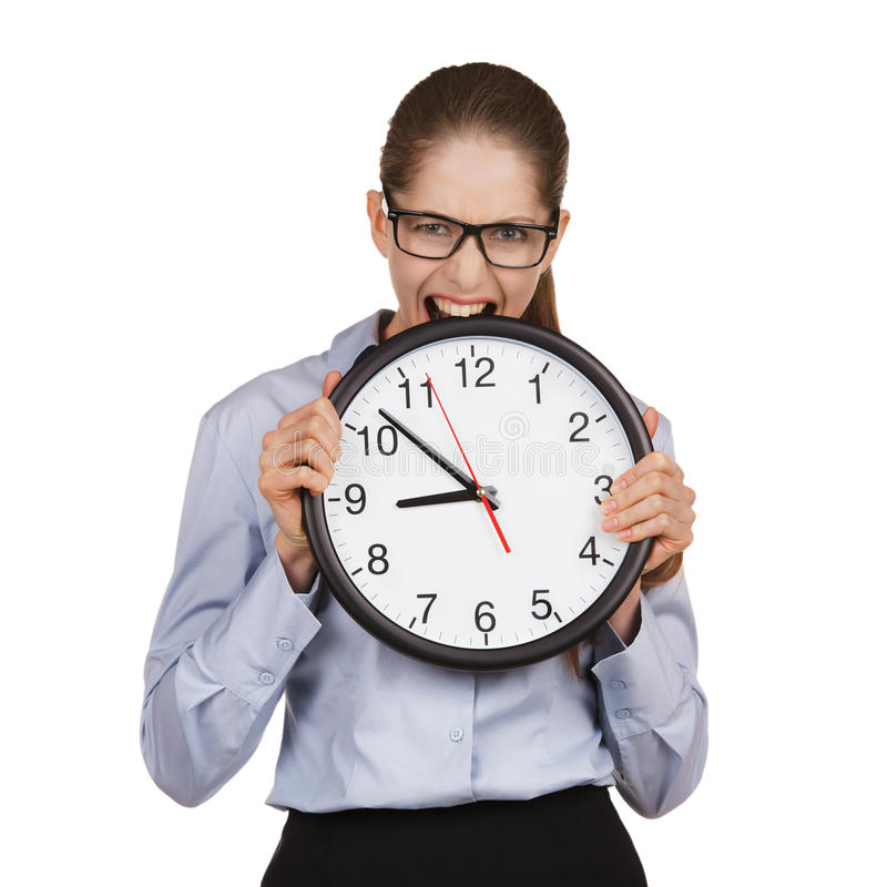 Girl in a state of stress bites the clock. Girl in a state of stress bites the big clock stock photography