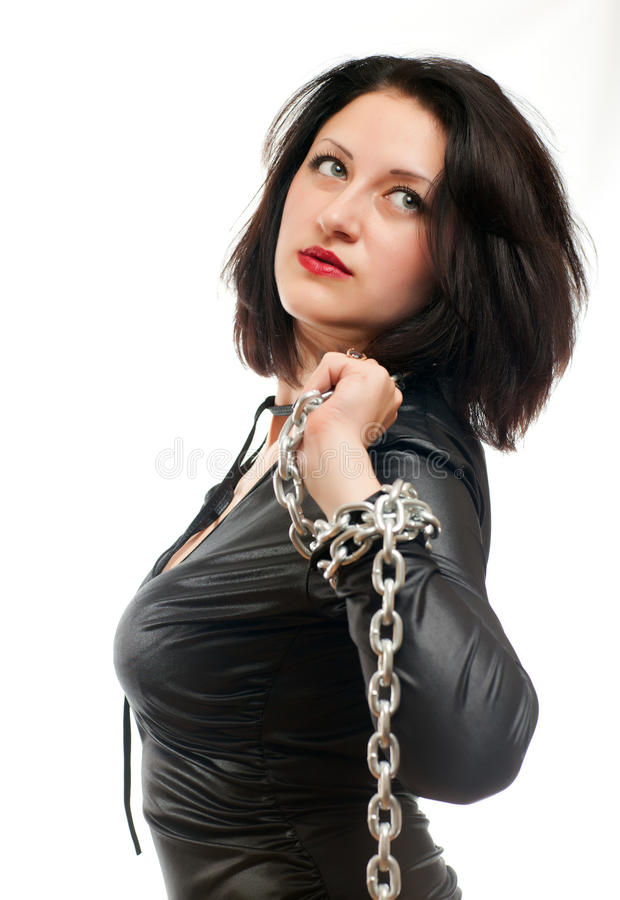 Girl and a steel chain. Seductive young girl holding a steel chain on a white background royalty free stock photo