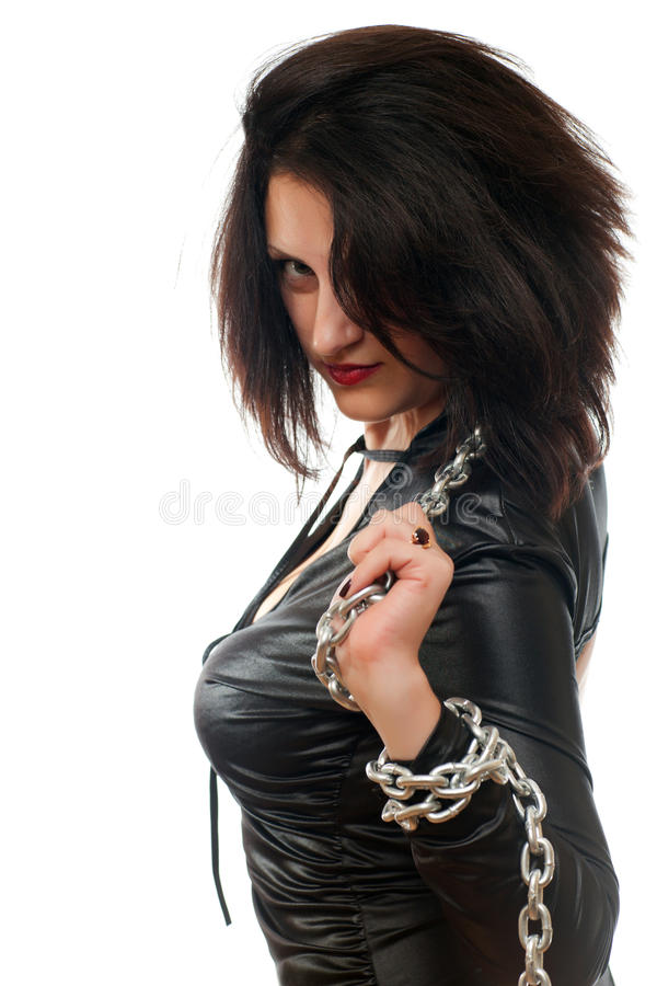 Girl and a steel chain. Seductive young girl holding a steel chain on a white background royalty free stock image
