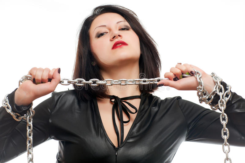 Girl and a steel chain. Seductive young girl holding a steel chain on a white background stock photography