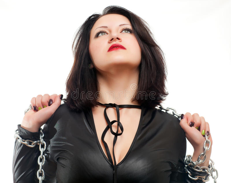 Girl and a steel chain. Seductive young girl holding a steel chain on a white background stock images