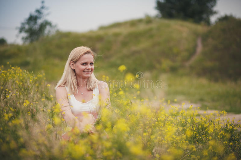 Girl straightens her hair in nature. The wedding ceremony beautiful bride and groom stylish summer fun smile joy royalty free stock photography