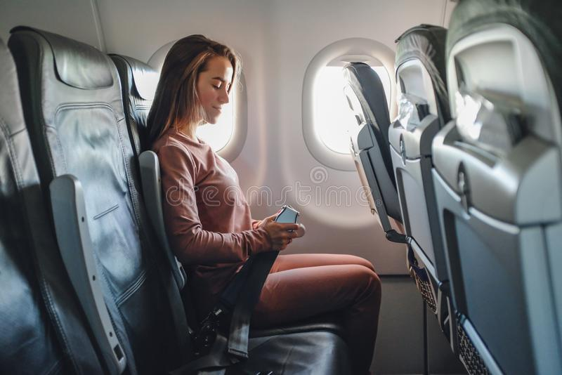 Girl is strapped on the plane royalty free stock photo