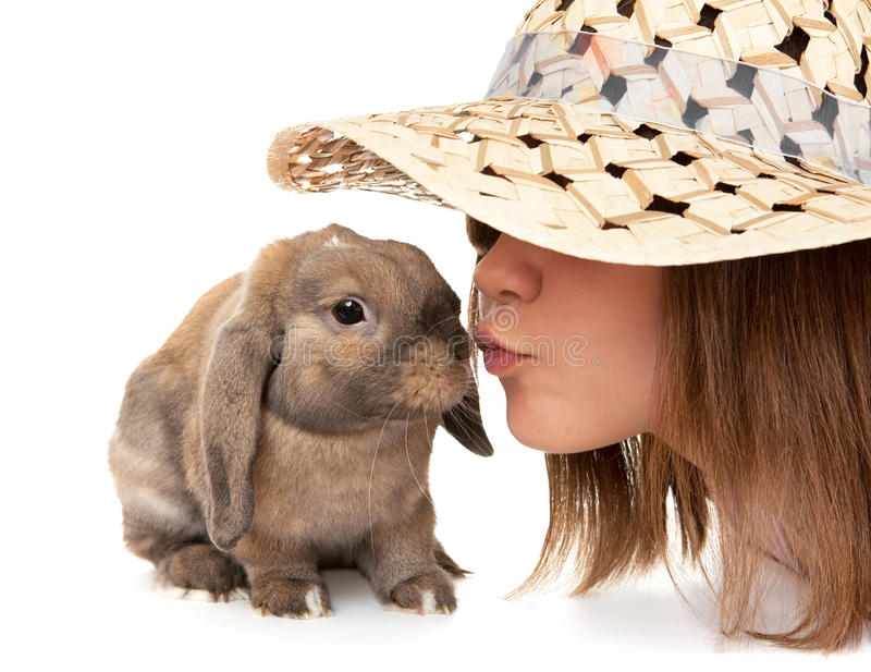 Girl in a straw hat kisses dwarf rabbit. In the Oriental calendar 2011 - the year of rabbit royalty free stock images