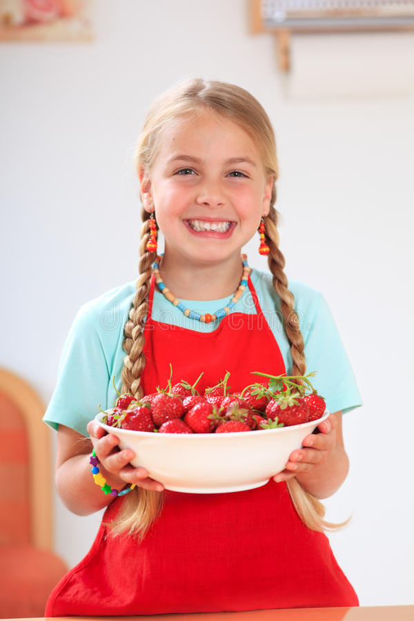 Girl With Strawberries Royalty Free Stock Photography