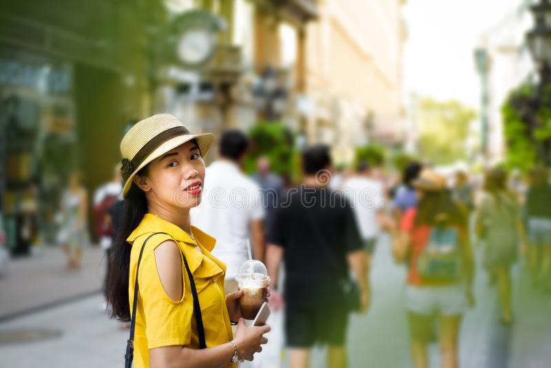 Girl on the street with coffee to go royalty free stock photo