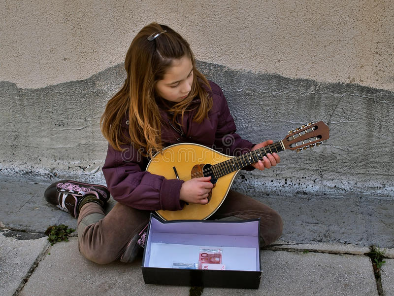 Girl - a street musician royalty free stock photography