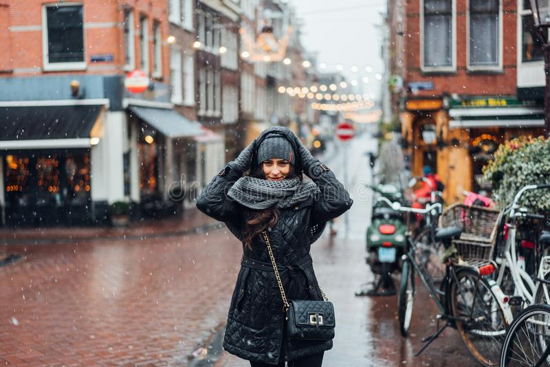Girl in the street in the rain. Posing on the camera stock images