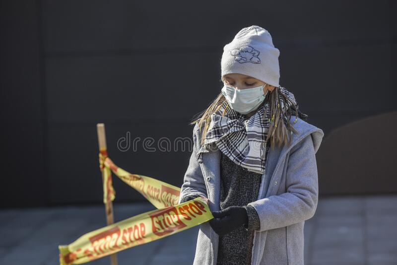 Child on pandemic days at the streets royalty free stock image