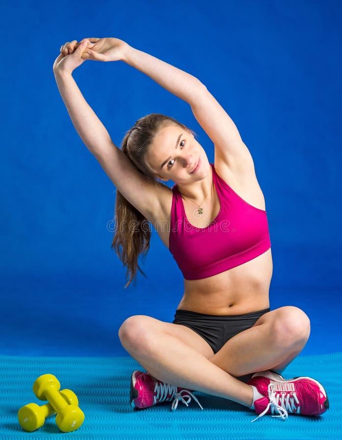 Girl stretching exercise stock photo