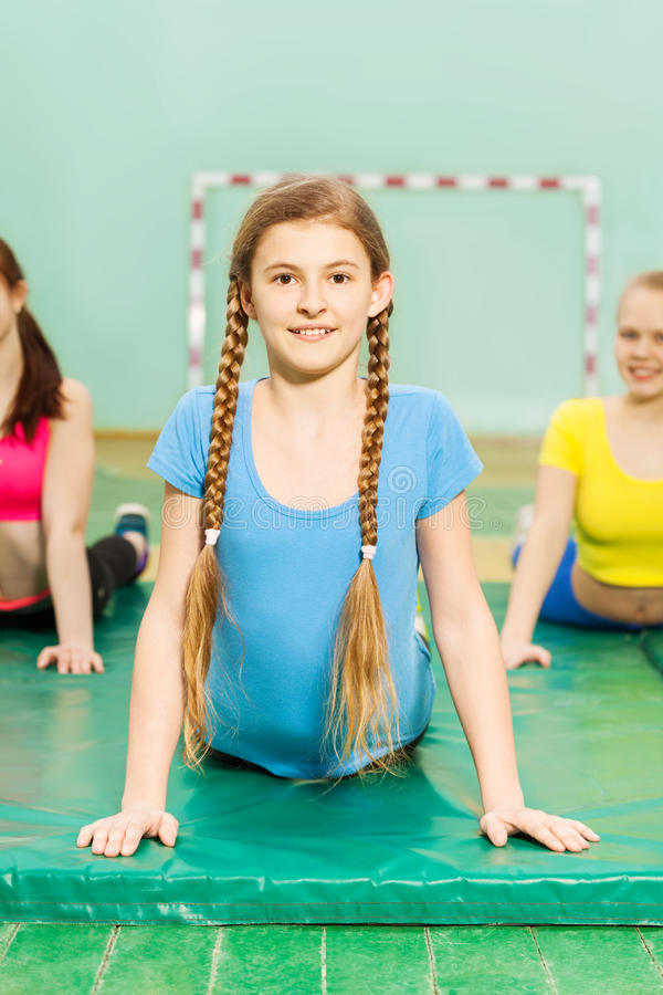 Girl stretching her back during gymnastic class royalty free stock photo