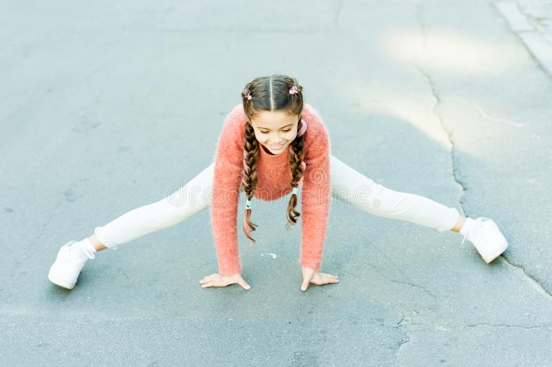 Girl stretching before long walk. Little child enjoy activity. Kid walking running outdoors. Enjoy walk. Sport for kids. Vacation and free time. Easy exercise stock images