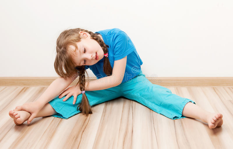 Girl Stretching The Muscles Stock Photos