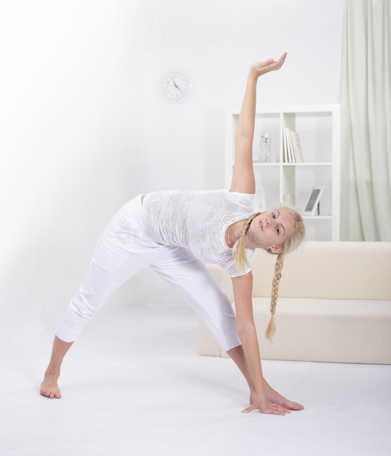 Girl stretching muscles stock photo