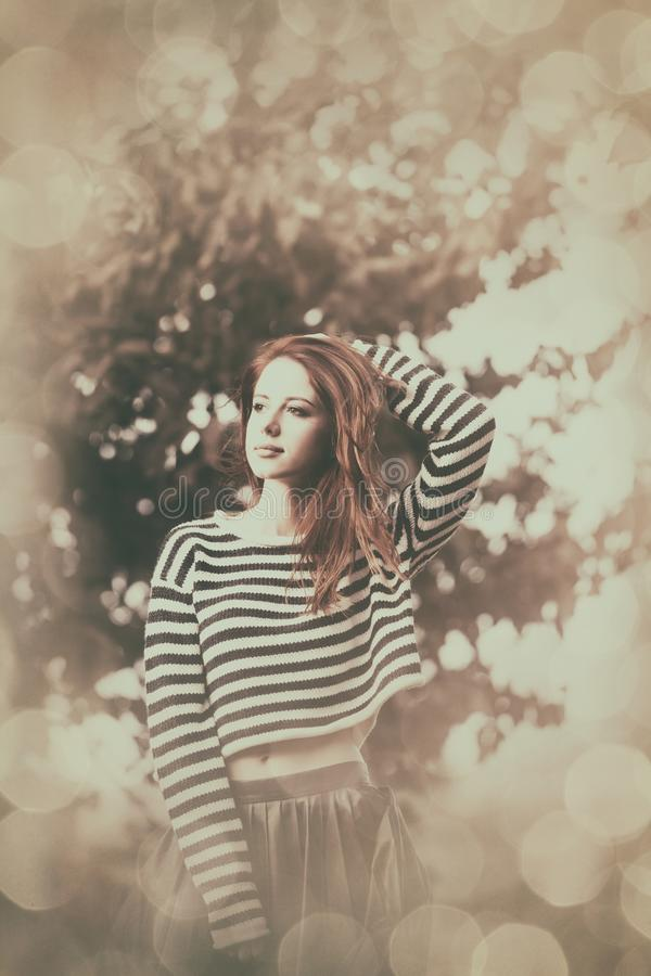 Girl in striped sweater royalty free stock photography