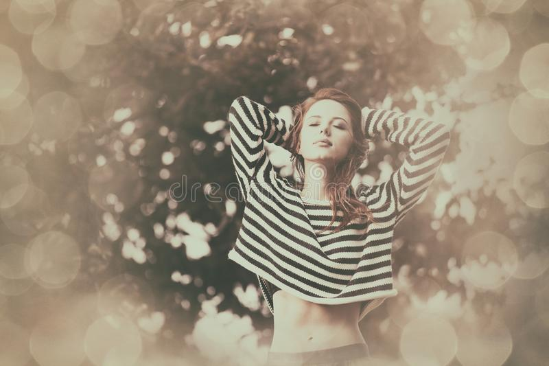 Girl in striped sweater stock photos
