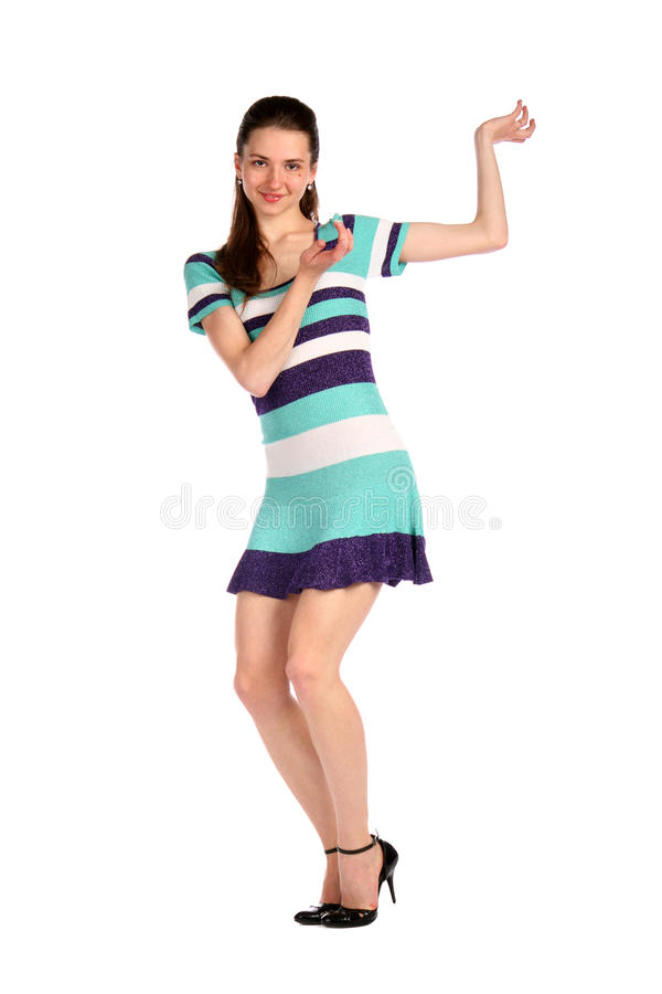Girl in stripy blue dress dancing. Isolated on white royalty free stock images