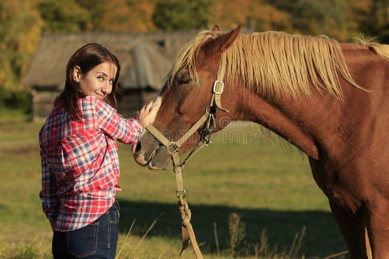 Girl Strokes A Horse stock photo