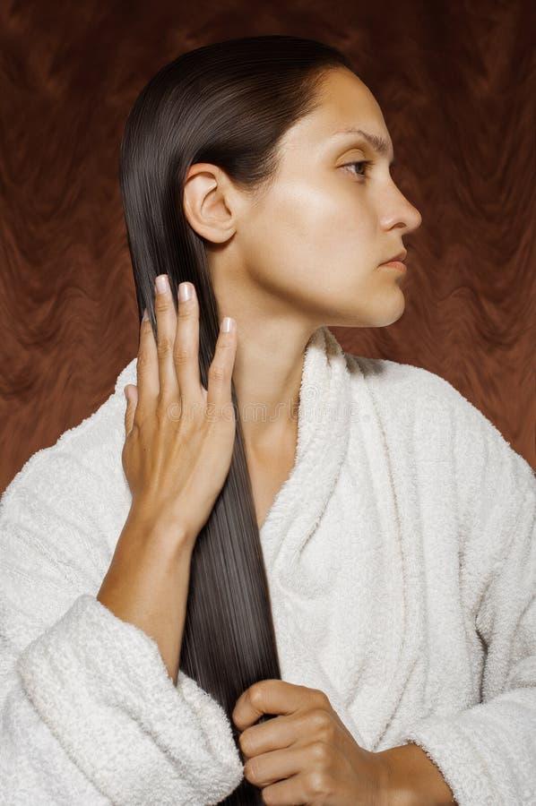 Girl stroking the wet hair royalty free stock photos