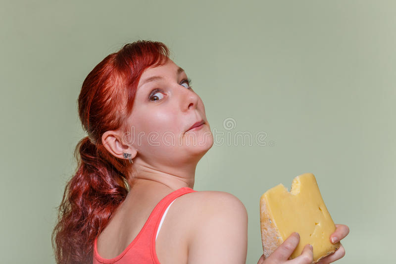 Girl with stubby cheese stock image