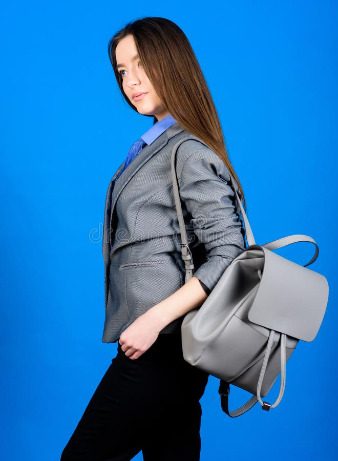 Girl student in formal clothes. Backpack fashion trend. Woman with leather knapsack. Stylish woman in jacket with. Leather backpack. Formal style accessories stock photo