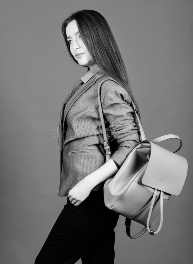 Girl student in formal clothes. Backpack fashion trend. Woman with leather knapsack. Stylish woman in jacket with. Leather backpack. Formal style accessories stock photos