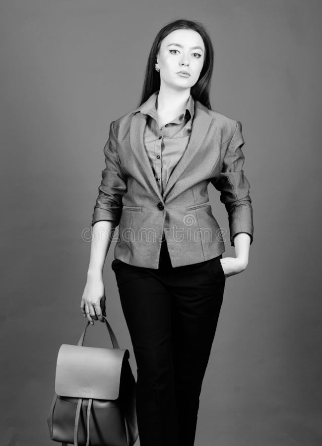 Girl student in formal clothes. business. Shool girl with knapsack. student life. Smart beauty. Nerd. stylish woman in. Jacket with leather backpack. female bag royalty free stock photos