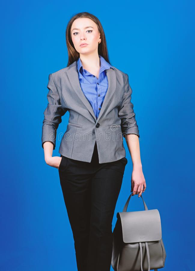 Girl student in formal clothes. business. Shool girl with knapsack. student life. Smart beauty. Nerd. stylish woman in. Jacket with leather backpack. female bag royalty free stock photo