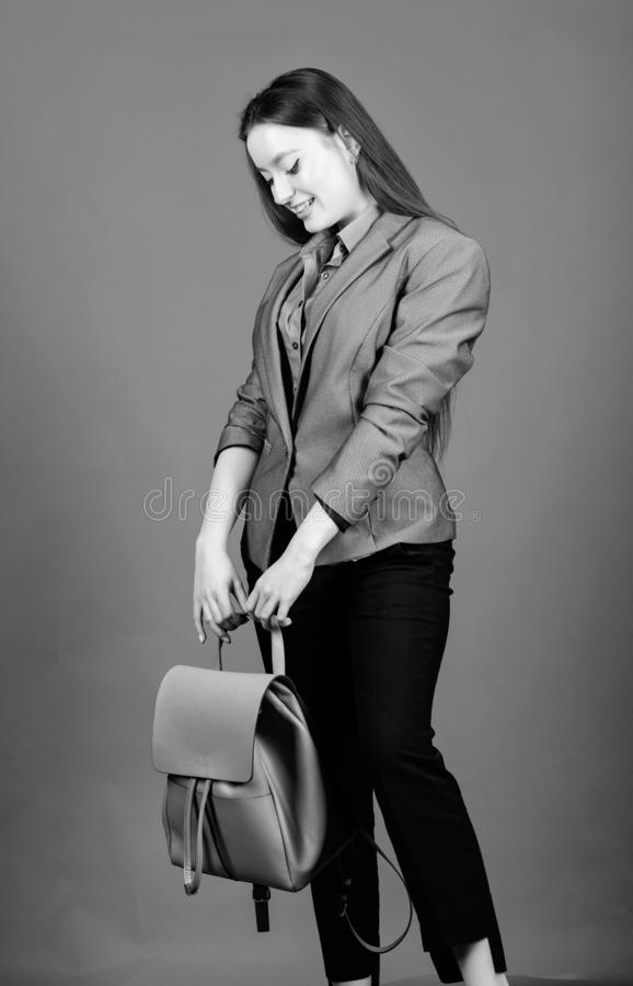 Girl student in formal clothes. female bag fashion. business. Shool girl with knapsack. student life. Smart beauty. Nerd. Stylish woman in jacket with leather stock images