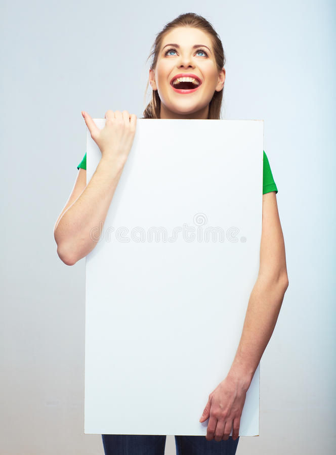 Girl student hold white blank board. White background young wom royalty free stock photo