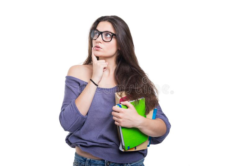 Girl student holding a book in her hand thinking stock photos