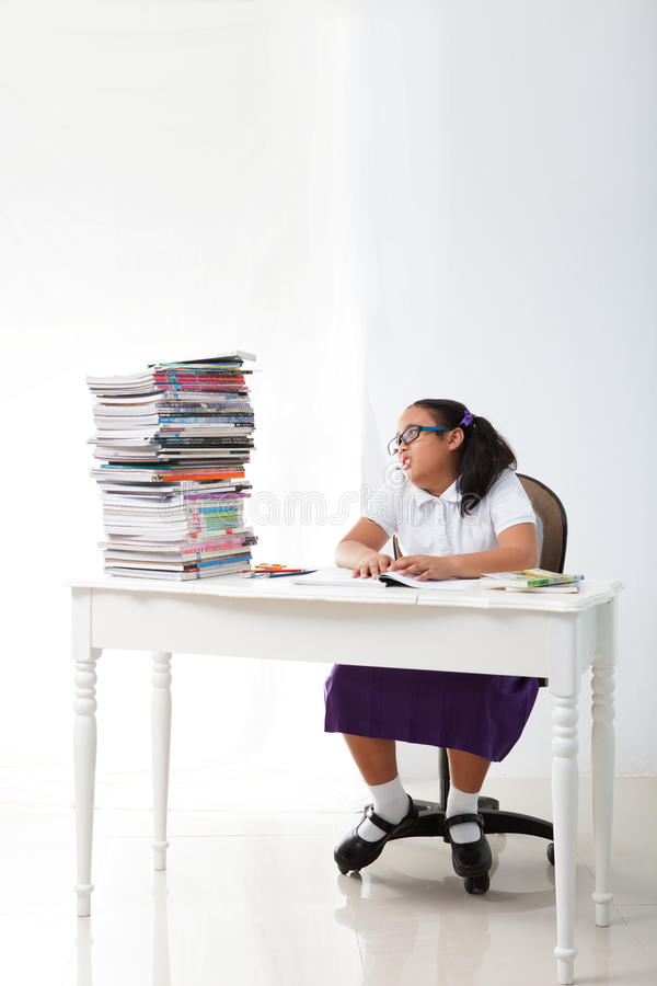 Girl student  look at big group of  a book