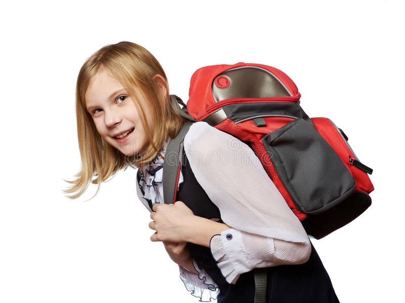 Girl student of school drags heavy bag isolated royalty free stock photo