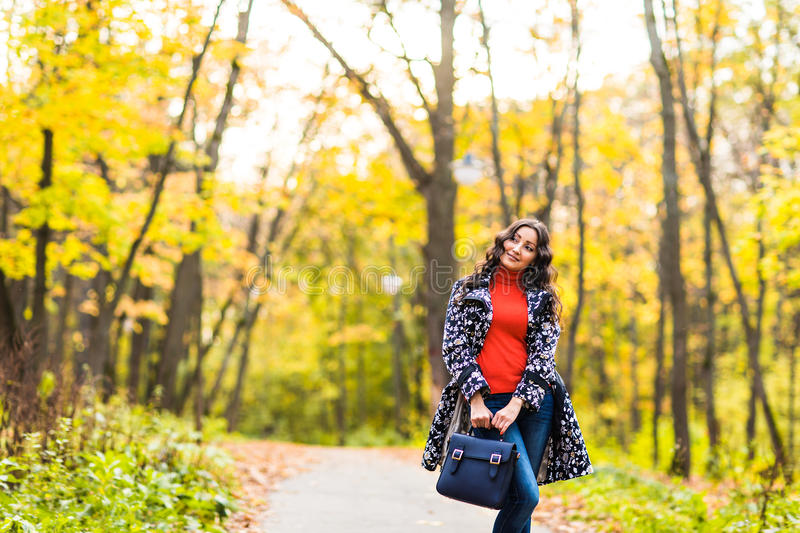 Girl student walking in the autumn park royalty free stock images