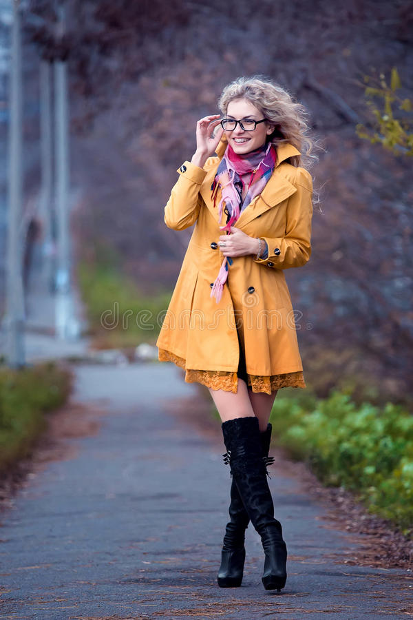 Girl student walks in the park. royalty free stock images