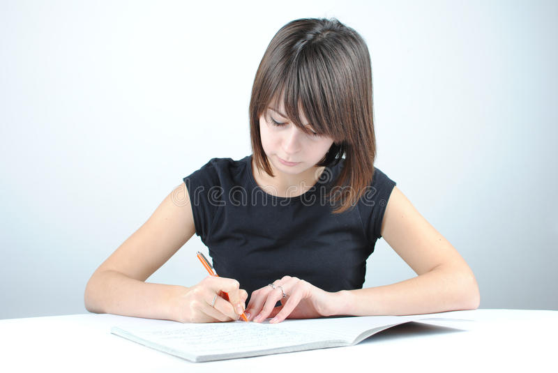 Download Girl student writes stock photo. Image of book, check - 21054238