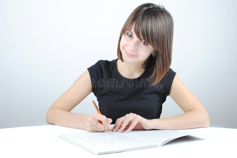 Girl student writes