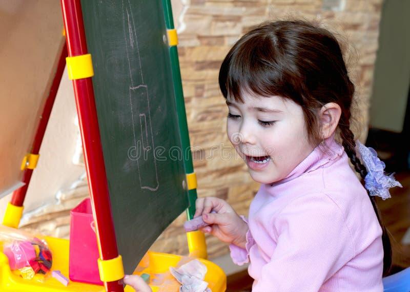 The girl studies, draws stock photos