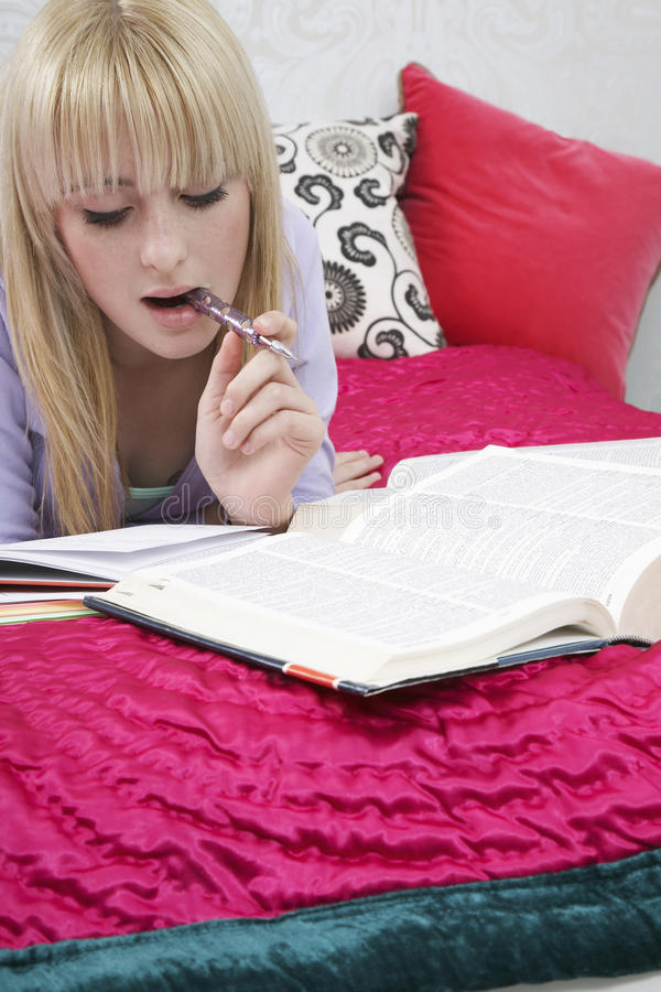 Girl Studying In Bed stock images