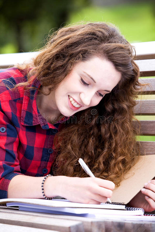 Girl studying outdoors royalty free stock images
